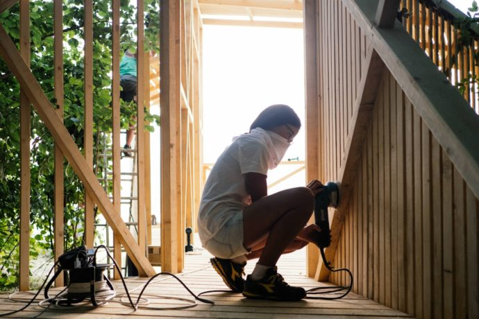 A workshop participant works on the interior of the observatory.